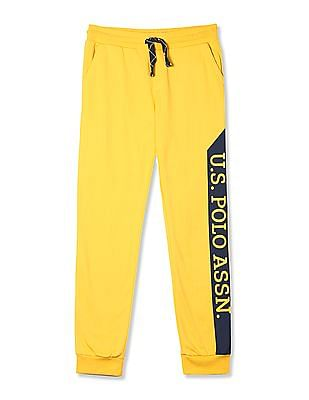 U.S. Polo Assn. Kids Yellow Boys Mid Rise Knit Track Pants